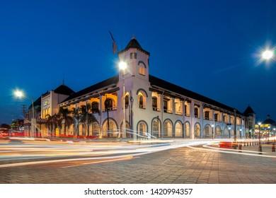 """Semarang / Indonesia - June 06 2019: The Building of Mandiri Bank at the Old City Semarang complex, former """"De Factorij"""" of Nederlandse Handel Maatschappij (NHM), photo taken when blue hour."""