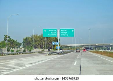 Semarang / Indonesia - June 6 2019: Cars passing by along Semarang–Solo Toll Road, a part of Trans-Java toll road that connects Semarang, capital city of Central Java and Surakarta (Solo).