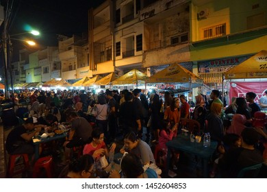 Semarang, Indonesia- June 8, 2019: The view of food stalls and the people at Semawis Market Semarang. Afamous traditional culinary market in Semarang chinatown.