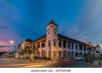 """Semarang, Indonesia - March 11 2021: The Building of Mandiri Bank at the Old City Semarang complex, former """"De Factorij"""" of Nederlandse Handel Maatschappij (NHM), photo taken when blue hour."""