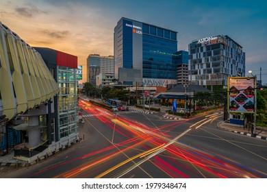 Semarang, Indonesia - May 23 2021 : sunset time with light trails of the vehicles at Pandanaran street Semarang