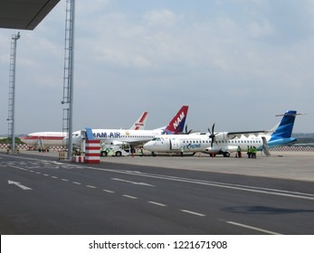Semarang, Indonesia - October 28, 2018: Three airplanes park on the tarmac in Ahmad Yani International Airport.