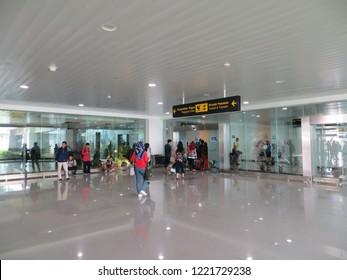 Semarang, Indonesia - October 28, 2018: Passengers of commercial airlines disembark into terminal in Ahmad Yani International airport.
