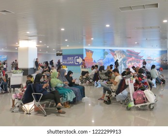 Semarang, Indonesia - October 28, 2018: Airline passengers at the waiting room in Ahmad Yani International airport.