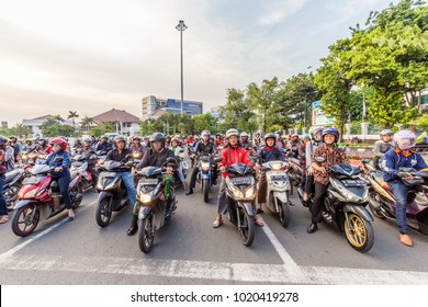 Semarang, Indonesia - October, 31, 2017: Scooters waiting for a traffic light in the center of Semarang, West Java, Indonesia