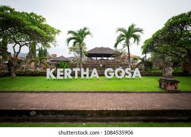 Semarapura, Bali / Indonesia - December 28 2017: Wide view of the Kertha Gosa symbol in the garden of Kertha Gosa temple
