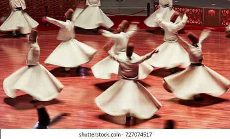 Semazen or Whirling Dervishes, Konya. Sufi whirling dervish (Semazen) dances at . Semazen conveys God's spiritual gift to those are witnessing the ritual.
