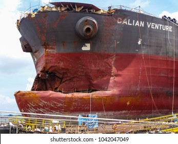 Sembawang / Singapore - November 5 2013 : A VLCC (tanker) damaged in a collision in the congested waters of Singapore Strait, lies at a repair yard in Sembawang.