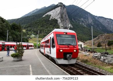 SEMBRANCHER, SWITZERLAND - JUNE 28, 2014: Trains at Sembrancher railway station in Switzerland