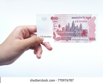 Sementa -Klang , Malaysia - 7 December 2017 : Concept image of hand hold a Combodia money with white background.Business/Education concept.