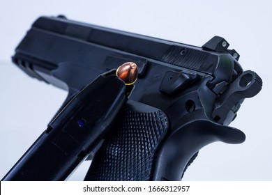 Semi Automatic 9mm Pistol with a Loaded Magazine on the side