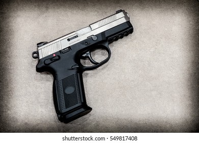 Semi Automatic Pistol on concrete