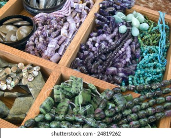 Semi precious gemstone beads in a wooden display case
