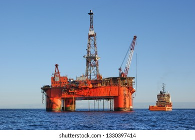 Semi submersible drilling rig doing cargo operations with supply vessel in the north sea. Offshore job. North sea rig, platform.