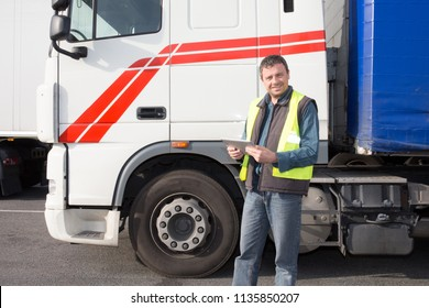 Semi Truck Caucasian man Driver with tablet Preparing For the Next Destination delivery