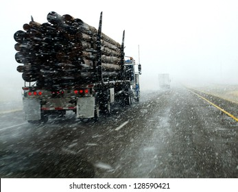 Semi truck driving down highway during blizzard snow storm