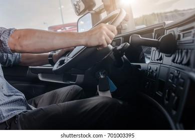 Semi Truck Driving Job. Caucasian Men Behind Semi Truck Steering Wheel.  Cabin Interior.