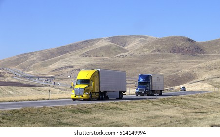 SEMI TRUCK DRIVING ON HIGHWAY, USA - October 20, 2016: Semi truck going fast on the desert mountain highway