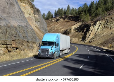 SEMI TRUCK DRIVING ON MOUNTAIN HIGHWAY,  MONTANA - DECEMBER 10, 2016: Semi truck driving on mountain highway