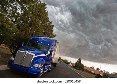 Semi Truck in the industrial area under heavy clouds