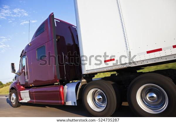 Semi truck in motion - seen on the highway in Nebraska.