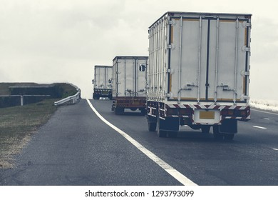 Semi Truck on highway road with container, transportation concept.,import,export logistic industrial Transporting Land transport on the asphalt expressway.motion blurred to soft focus