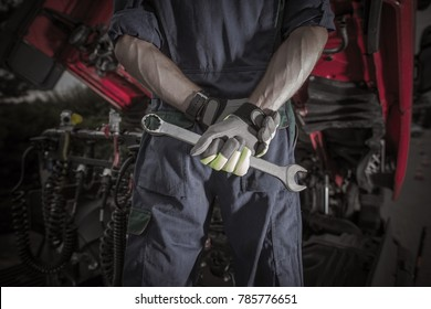 Semi Truck Pro Mechanic. Caucasian Service Worker with Heavy Duty Wrench Preparing For Complicated Truck Fix.