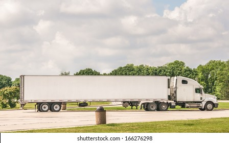 Semi truck at a rest area on Interstate I-55 , on June 10, 2013. The freight volume in the United States expected to grow by more than 80 percent in the next 20 years, says news report