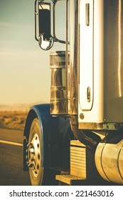 Semi Truck Tractor Closeup on the Highway in Vertical Photography.