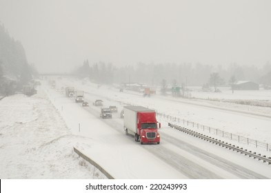 Semi truck traffic on Interstate 5 during a winter snow and freezing rain storm