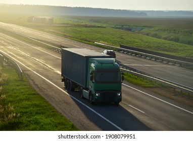 Semi truck transporting sea container on highway on sunset background. Shipping Containers Delivery, Maritime Services and Transport logistics. Shipping Container on lorry. Semi-tractor-trailer truck