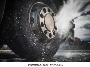 Semi Truck Wheels High Pressured Water Washing Closeup Photo.