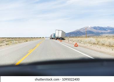 Semi Trucks Pulled Over on Highway with Hazard Triangles
