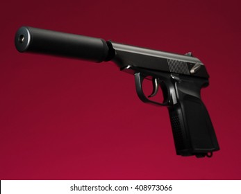 semi-automatic hand gun on red background, with silencer/suppressor