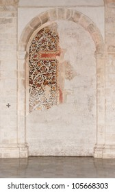 Semicircular niche with fresco remains in medieval castle church in Milazzo, Sicily
