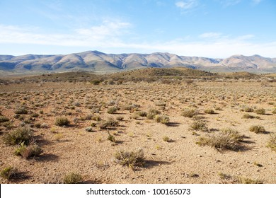 Semi-desert region in South Africa with mountains and blue sky