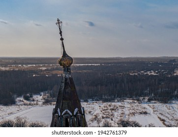 The semi-destroyed dome of the Church of the Resurrection of Christ in winter in village Ostrov, Yaroslavl Region, Russia - Shutterstock ID 1942761379