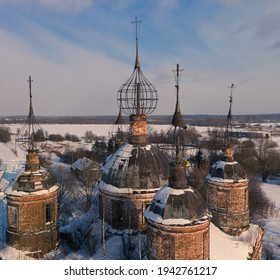 The semi-destroyed domes of the Church of the Resurrection of Christ on a sunny winter day in village Ostrov, Yaroslavl Region, Russia - Shutterstock ID 1942761217