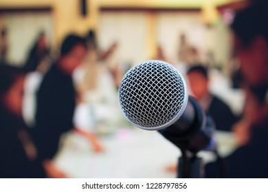 Seminar Conference Concept : Close-up Microphones on abstract blurred of speech in meeting room, front speaking blur people in event convention hall in hotel background