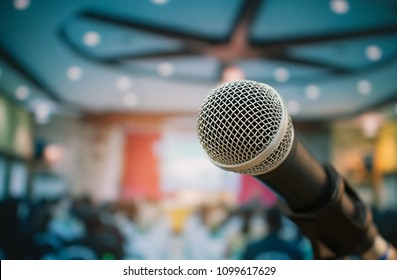 Seminar Conference Concept : Microphones for speech or speaking  in seminar room, talking for lecture to audience university, Event light convention hall Background.