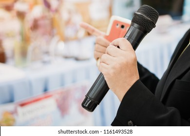 Seminar Conference Concept: Smart businessman speech and speaking with microphones in seminar room or talking conference hall light with microphone and keynote. Event light convention hall Background