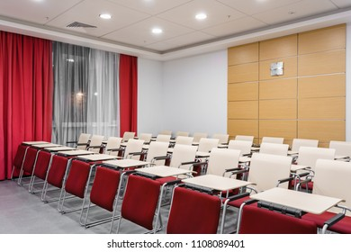 Seminar presentation. Empty conference room, lots of empty seats. Auditorium for workshops and seminars. Red color.