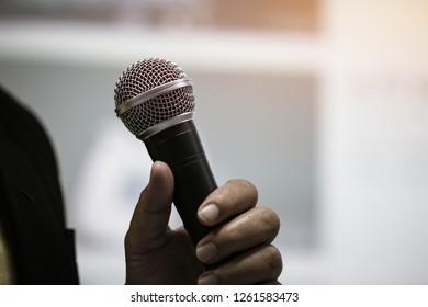 Seminar Speaking Conference Concept : Microphone of speech in seminar room or speaking conference hall light bokeh background. Speaker Business tedtalk is vocalized form communication humans, vintage