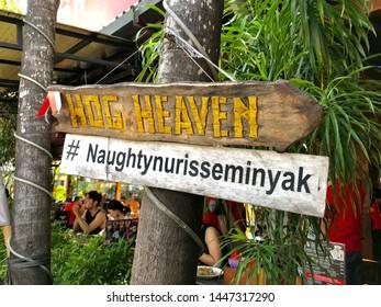 Seminyak, Bali/Indonesia - 06 09 2019: Naughty Nuri's Warung restaurant hashtag sign in Seminyak, Bali, Indonesia