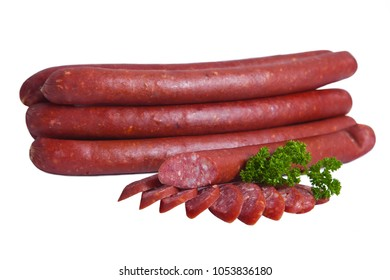Semi-smoked sausage in natural shell. Meat product whole and partially sliced. Isolated on white background