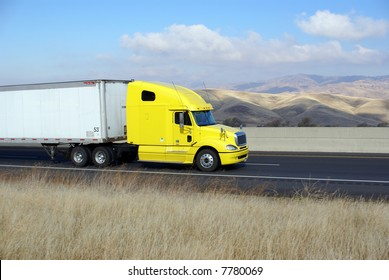 Semi-trailer rig heads west into the Sierra Nevada Mountains, California