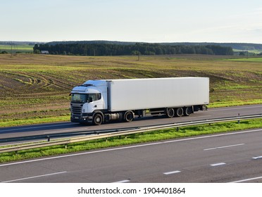 Semi-trailer truck SCANIA driving along highway on blue sky background. Goods Delivery by roads. RUSSIA, MOSCOW REGION - SEPT 16, 2020