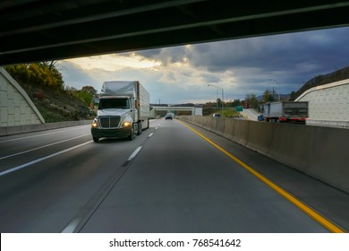 Semi-truck commercial vehicle and highway underpass