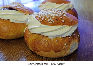 Semla (Swedish) or laskiaispulla (Finnish) is a traditional sweet roll. Wheat bun with top cut off and filled with a mix of milk and almond paste (or strawberry jam), topped with whipped cream.