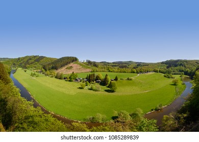 Semois river, Bouillon, Ardennes, Belgium. Panorama view on meander of semois river. Belgian countryside grass fields with hills in background, Luxembourg province, Ardennes region, Wallonia, Belgium.